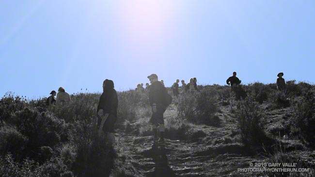 Hikers ascending and descending the trail on the west side of Mugu Peak
