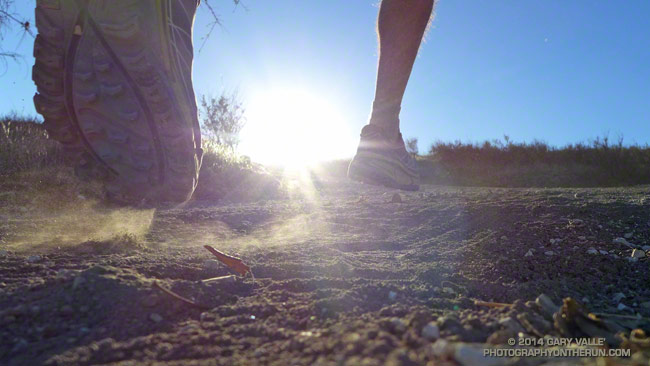 Running up a hill in the Hoka One One Mafate Speed