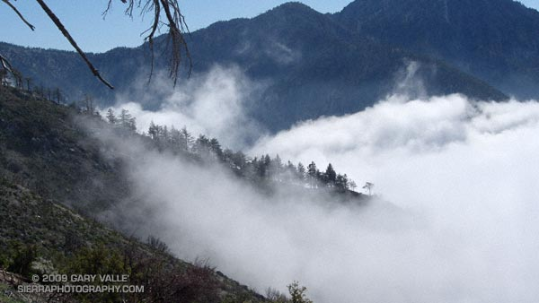 Clouds pushing up San Antonio Canyon and the southeastern slopes of Mt. Baldy.