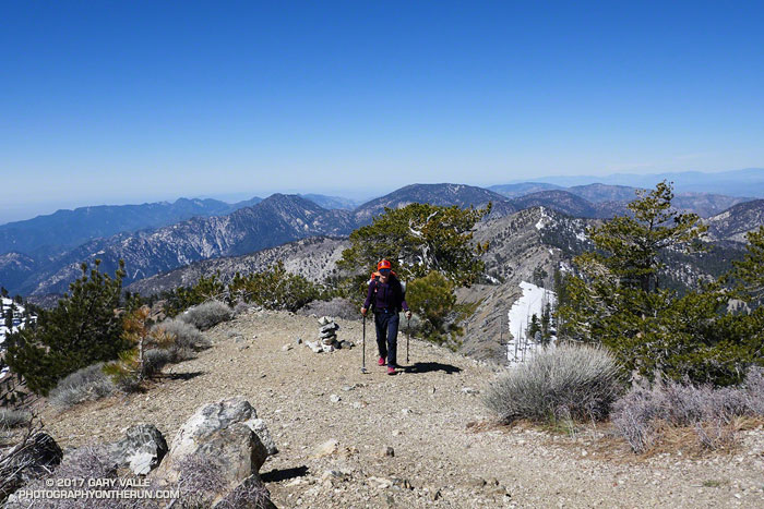 Patty on the summit of Mt. Hawkins. Twin Peaks, Mt. Waterman and the Mt. Wilson area can be seen in the background.