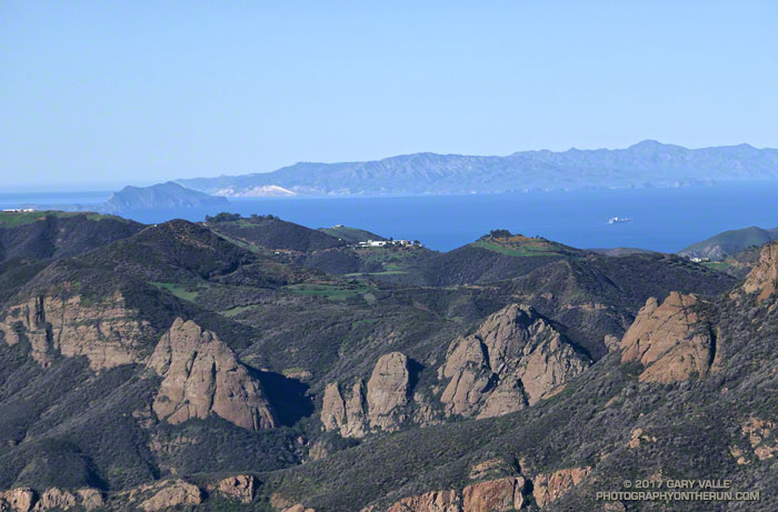 Rock formations along the Backbone trail with Anacapa and Santa Cruz Islands in the distance.