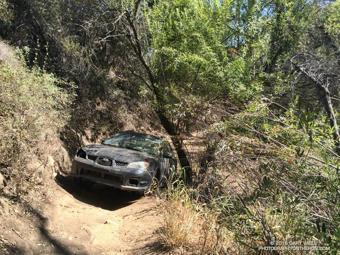 Subaru Impreza abandoned at Sulphur Springs on the the Cheeseboro Canyon Trail. July 13, 2016.