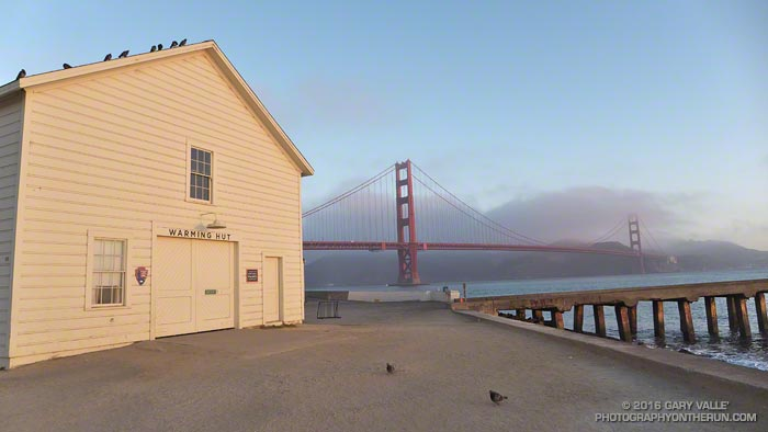 Warming Hut and Golden Gate Bridge at sunrise from the Golden Gate Promenade