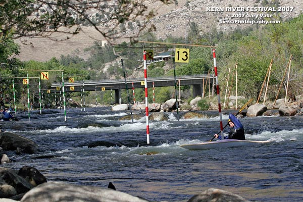 Looking upstream at the 2007 Kern River Festival T.J. Slalom course. A kayaker is turning into upstream gate #13.